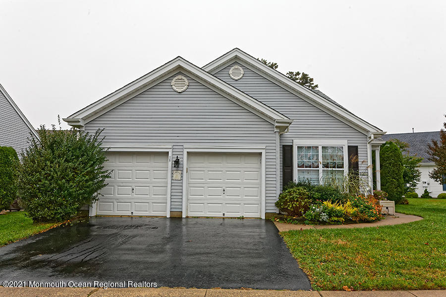This Lovely Hatteras Model has much to offer.  Original owner-No Pets-No Smokers. The Open Floor Plan features good site lines.  The Kitchen has beautiful Granite Counters and a Breakfast Bar.The All Season's Room is part of the home- opened up and has A/C  & Heat. A very private setting and patio in the backyard.There are Hardwood Floors in the Dining Room & Family Room which has a Free Standing  Fireplace.   The Master Bedroom has a WIC /&Master Bath with Double Sinks.  The home features Plantation Style Blinds throughout.  Crown Molding/Ceiling Fans.  The 2nd Bedroom has a Murphy Bed for guests or use as an office.Visit this lovely home soon.  Nearby all Major Highways/Restaurants/Beaches & Shopping.