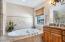 Jacuzzi soaking tub and double vanities