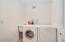 The Bosch washer and dryer are conveniently located on the second floor and are included in the sale of the property.