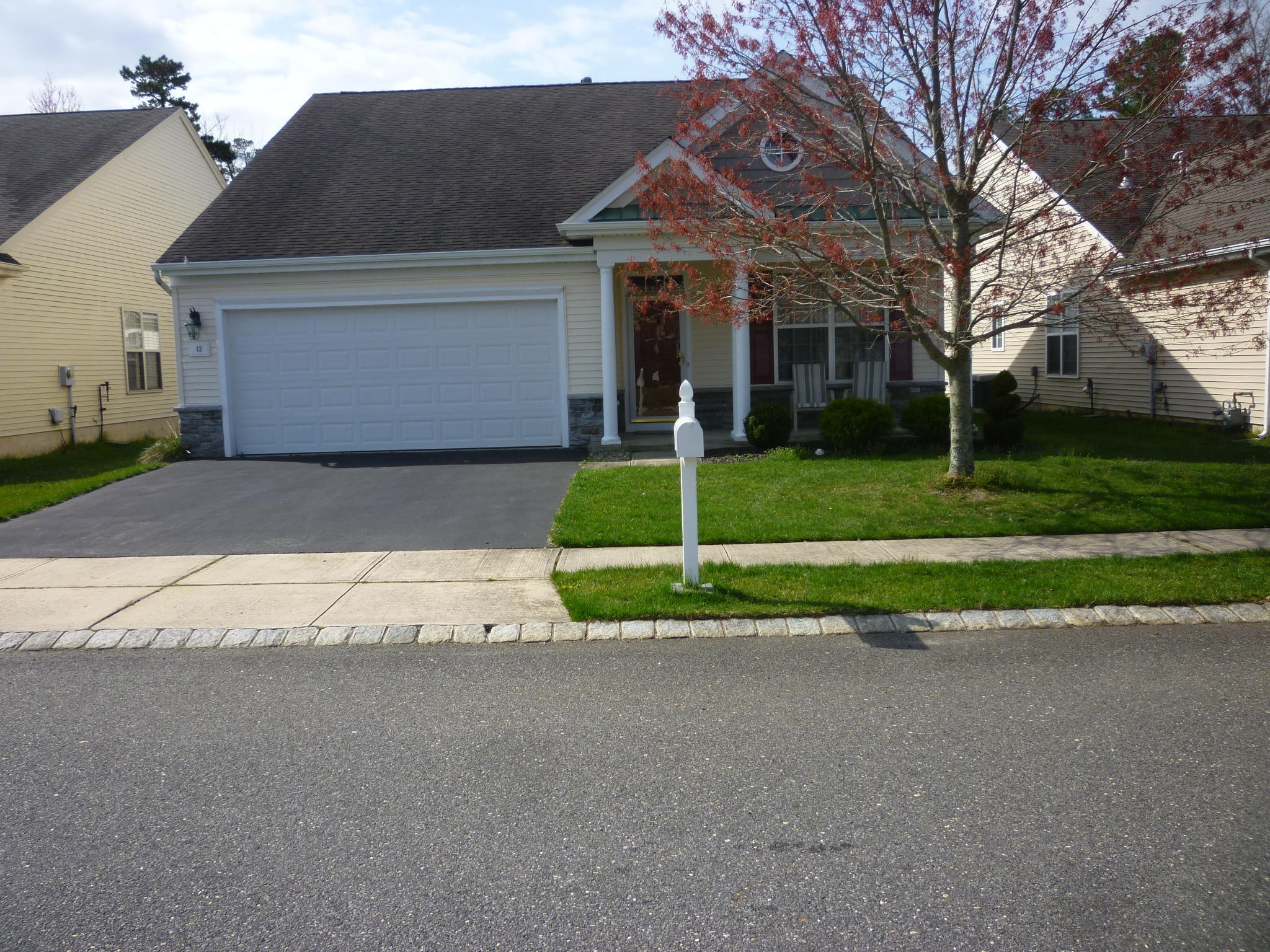 ESTATE SALE! Quick closing possible on this Newport Model. Open floor plan, with newer laminate flooring. Family room and a living room with a dining area. Center island eat-in kitchen, with stainless steel appliances. Hot water heater replaced in 2017. New furnace as of 12-14-2020. Master bedroom with plenty of closet space, double vanity sinks, ceramic floor, linen closet, separate shower stall and tub.  Guest bedroom, with full bathroom in hallway.  Nice open front porch and a backyard patio. All appliances are included.  All remaining personal items will be cleared out of the home on April 24, 2021.