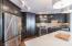Custom cabinets with glass backsplash.