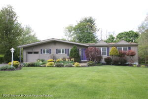 Immaculate 3 bedroom, 3 full bath spacious ranch nestled on a large manicured lot with mature professional landscaping!