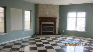 Living room with a gas fireplace.