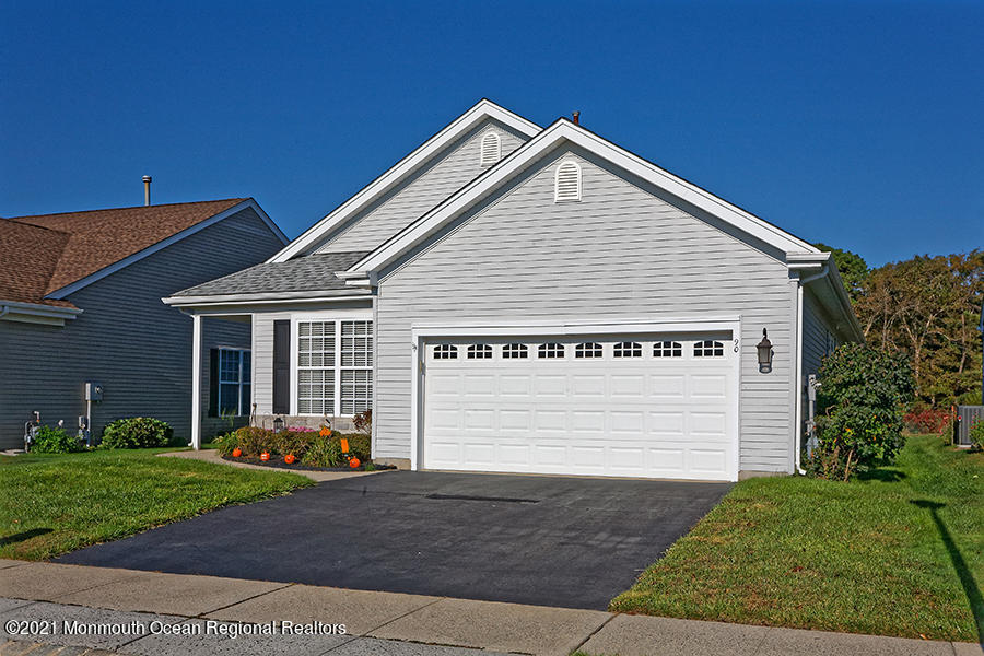 This very lovely Hatteras Model has been lovingly cared for by the original owner.Featuring Hot Water Baseboard Heat-The Central A/C is serviced yearly. The home features beautiful Hardwood Flooring/Gas Fireplace in the Family Room/SunRoom is gorgeous and looks out to the beautiful Patio which is very private-no backyard neighbors. The Master Bedroom has a generous Walk-in-closet and private Master Bath.  Entertain your overnight guests with the additional Bedroom and nearby Full Bathroom.  You can walk to the Clubhouse for all the events or to use the Gym facility/Library/ . A full appliance package is offered. This is a much sought after community with low monthly fees. Nearby all Major Highways/Restaurants/Beaches.  This one won't last. .