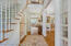 """Two-story 19' x 4' 6"""" foyer. Hall closet and powder room are on the far left."""
