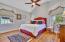 13' x 12'. Vaulted ceiling and hardwood floors.