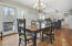 Crisp white kitchen, granite counters, stainless appliances