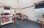 Twin bedroom, hardwoods underneath carpeting