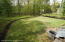 Over 1/2 acre, your dogs and kids will LOVE THIS !