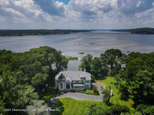 This stunning European style home is located in the perfect location at the mouth of the Navesink River with outstanding views!