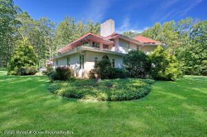 Custom Mediterranean Style home on 2.73 parklike acreage