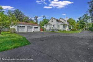 LOADED WITH SPACE and so much potential! Large backyard and three car garage and paved driveway