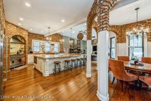 """French Country Kitchen / Family Room w/ 10', 12' and 17' Ceilings. 6"""" Wood Floors w/ Radiant Heat, Stone and Brick walls, Countertops of Butch block and granite."""