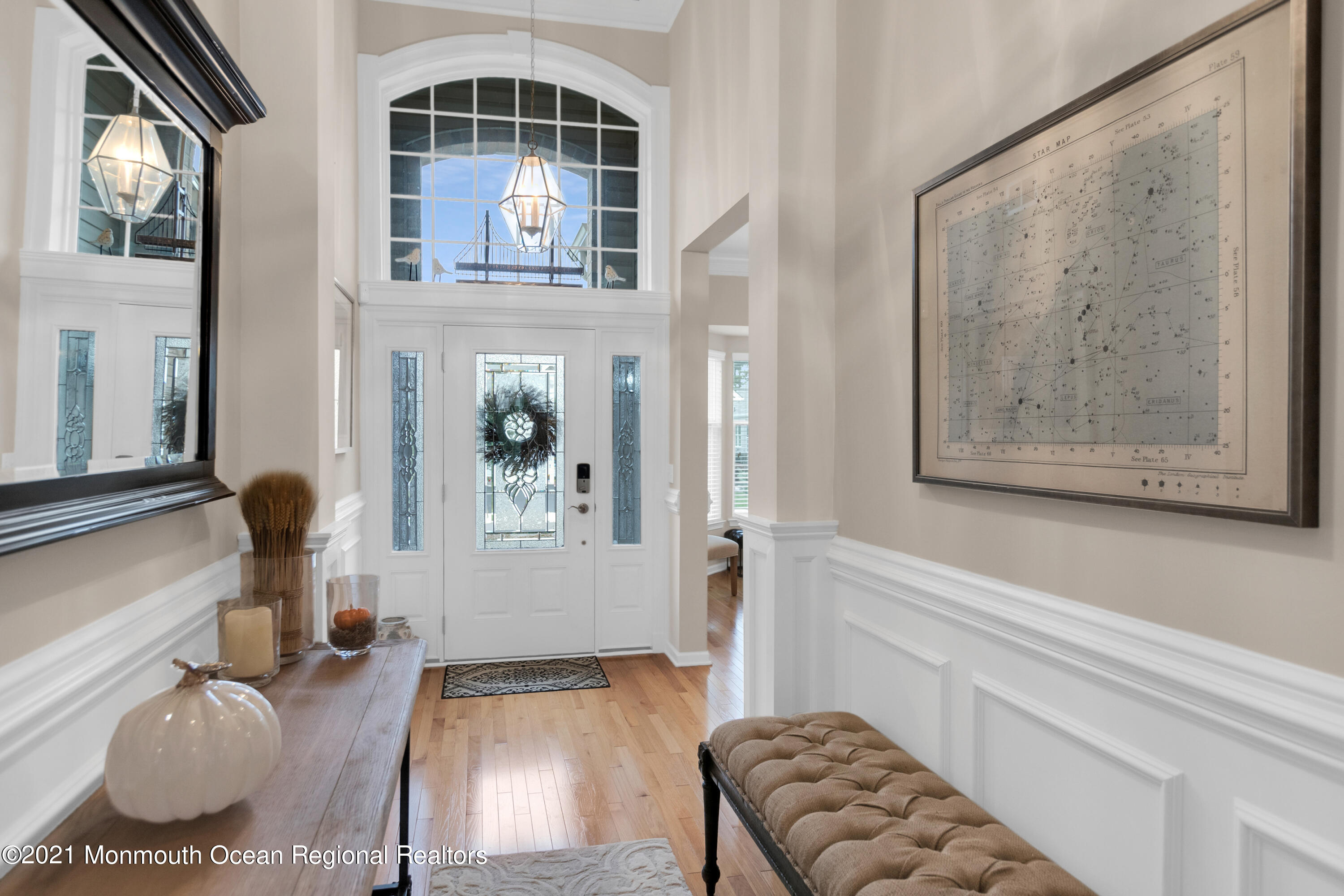 Step into this elegant home which greets you with a grand two-story foyer, open living space, custom moldings, and trim work. Located in a private gated community just off the GS Parkway and just a short ride to Atlantic City, many marinas, shopping, and recreation. This home features a gourmet kitchen with upgraded 42 in. cabinetry, a large pantry, and modern stainless-steel appliances, stunning natural stone countertops with a large peninsula island that opens to the family room. Find hardwood floors throughout the living/family room, dining room, and kitchen. Distinguished 8-foot doors and Custom moldings throughout and 9 ft high space. 2 Bedrooms including a Master suite with tray ceiling, recessed lights and walk-in closet on main floor and an additional bonus study/office.  The main level is completed by a spacious laundry room.  The fully finished basement features a family media center with built-ins and a second Master suite including a master bath and walk in closet. The perfect get-away place for guests.  Decide between relaxation or activity with a full-service Award-Winning Clubhouse which offers a spa, sauna, hot tub, fitness center, craft room, art room, library, pool tables, card room, shuffleboard, putting green, horseshoe, bocce courts, tennis, coffee station, outside fireplace, a heated pool, and many other amenities.  Or, just relax on your private covered patio overlooking the wooded area, ideal for your morning coffee or for outdoor entertaining.  There is so much to see.  You won't be disappointed!  Make your appointment today!