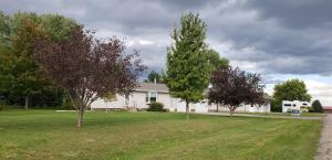 Ranch w/an Attached large 2+ Garage and a HUGE Detached Newer Garage w/tall doors for the large vehicles.