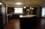 All Newer Appliances, Pantry, Pergo Flooring, Lighting, Quartz Counter-tops, Dark Cabinetry fronts,Tile Back-splash.