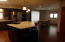 Opens up to the newer Dining area. Recessed lighting.