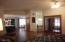 Pergo laminate type flooring and vaulted ceiling.