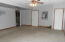 Walk-in into the Attached Double Garage & a back door to the Back Yard.
