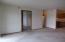 Door in Living room leads to the Den.