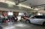 3 stall garage with heated floors, floor drain, work bench and sink
