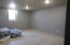 Sheetrock walls & electrical complete. Concrete floor.