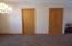 Pocket door to Kitchen & Closet door.