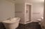 Soaker Tub, Walk-in Tiled Shower & Double Sinks.
