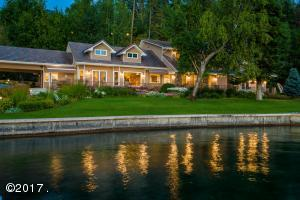 399' of Stunning Flathead Lake frontage with an exceptional home and guest home.