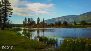 Gorgeous 300+' of Clark Fork River access with sandy beach and rock outcroppings.