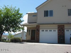 This south side open condo is an end unit with lots of sunshine.