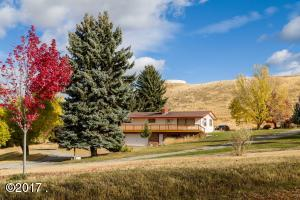 Rancher in Eureka, MT positioned on over 6 acres.