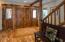 Custom entry doors, live edge trim, rain flow windows