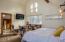 Loft bedroom suite has ample natural lighting