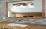 Loft vanity , granite counter and tile walls