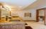 Radiant limestone tile flooring in master bath