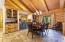 Formal dining room with built-in cabinets and pass-through counter to gourmet kitchen.
