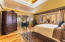 Master bedroom with french doors into master bath.