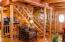 Main level living room/stairs/front door