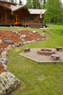 Exterior West Side With Fire Pit