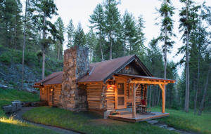 Rock fireplace anchors this beautiful and sweet cabin.