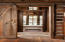 Sliding door & reclaimed wood -makes for warm and charming touches.
