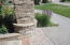 Front entrance aggregate walks and stone pillars
