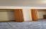 continuous wall closet wood doors