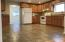 Kitchen with tile floors, wood cabinets and lots of canned lights with dimmers!