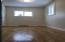 Bedroom on main floor with wood floor.