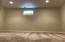 Large bonus room located in basement.