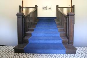 Lobby with original stairs.