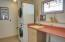 Spacious laundry room with sink
