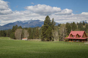 Views of the Bitterroot Mountain Range and the log home on Moondance Ranch.